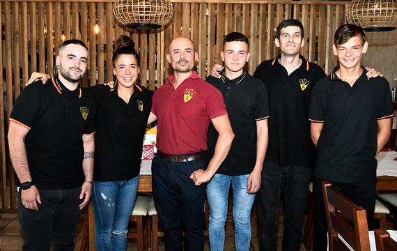 Owner and waiters of Mesón Carrión